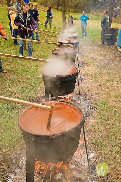 Bonnie and Galin Ingram. Apple butter making party. Kepner Road, Muncy, PA. Kettles