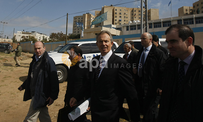 Former British prime minister and Middle East envoy Tony Blair (2nd R) visits Beit Hanun in the northern Gaza Strip, on March 1, 2009. Blair arrived in the Gaza Strip in his first visit to the Hamas-run enclave since being appointed Middle East Quartet envoy. APAIMAGES PHOTO / Ashraf Amra