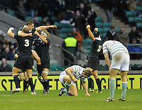 Twickenham, GREAT BRITAIN,  final whistle with a victorious Oxford celebrating in the background as Cambridge see their dream broken,   2012 Varsity Rugby match.  Oxford vs Cambridge, at the RFU Stadium, Twickenham, Surrey. on Thursday  06/12/2012...[Mandatory Credit; Peter Spurrier/Intersport-images]
