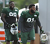 Sheldon Richardson #91 of New York Jets, right, and Jarvis Jenkins #98 laugh during team training camp at Atlantic Health Jets Training Center in Florham Park, NJ on Thursday, Aug. 4, 2016.