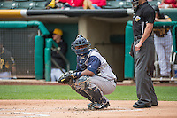 Robinson Diaz (7) of the Colorado Springs Sky Sox looks to the dugout for the sign against the Salt Lake Bees in Pacific Coast League action at Smith's Ballpark on May 24, 2015 in Salt Lake City, Utah.  (Stephen Smith/Four Seam Images)