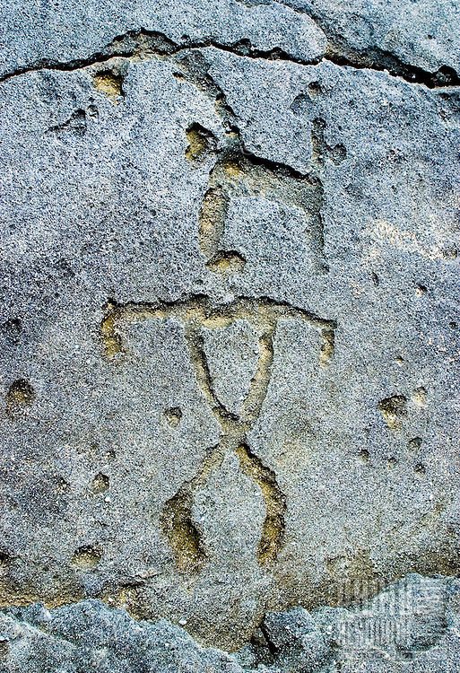 Hawaiian petryoglyphs are revealed after heavy waves at Keiki beach on the north shore of Oahu