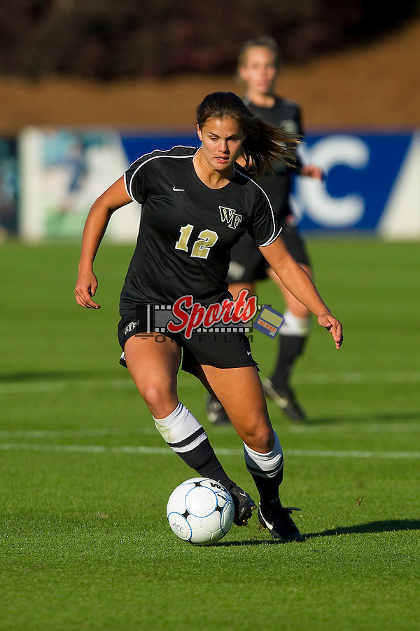 Katie Stengel #12 of the Wake Forest Demon Deacons dribbles the ball during first half action against the Maryland Terrapins at the 2010 ACC Women's Soccer Championship at WakeMed Soccer Park on November 7, 2010 in Cary, North Carolina.  The Demon Deacons defeated the Terrapins 3-1 in penalty kicks.  Photo by Brian Westerholt / Sports On Film