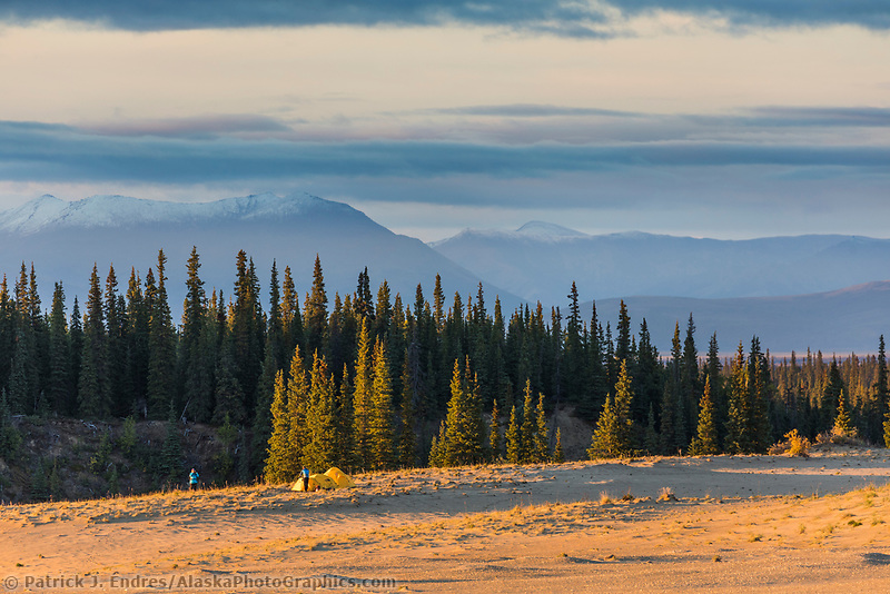 Hiking in the Great Kobuk Sand Dunes, Baird Mountains in the distance, Kobuk Valley National Park, Alaska.