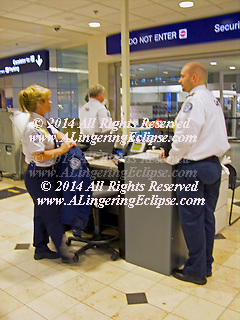 Minneapolis-Saint Paul International Airport TSA Security Checkpoint, Staff Members Perform the Jobs in a Professional, Methodical Manner Which Follows Protocol Keeping Travelers Safe.