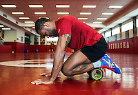 Olympic Gold champion wrestler Jordan Burroughs (cq) stretches before wrestling practice at the University of Nebraska in Lincoln, Nebraska, Friday, February 12, 2015. Burroughs still trains at the university where he wrestled as a student.<br /> <br /> Photo by Matt Nager