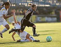 Tiffany Milbrett (right) leaps over Camille Abily (center) in pursuit of the ball, chased by Sharlota Nonen (left). LA Sol and FC Gold Pride tied 0-0 at Buck Shaw Stadium in Santa Clara, California on July 23, 2009.