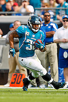 January 01, 2012: Jacksonville Jaguars running back Maurice Jones-Drew (32) runs with the ball during first half action between the Jacksonville Jaguars and the Indianapolis Colts played at EverBank Field in Jacksonville, Florida.  ........