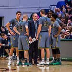 18 February 2018: University of Vermont Meghan and Robert Cioffi Men's Basketball Head Coach John Becker discusses strategy with his players during a time out against the Hartford Hawks at Patrick Gymnasium in Burlington, Vermont. The Catamounts fell to the Hawks 69-68 in their America East Conference matchup. Mandatory Credit: Ed Wolfstein Photo *** RAW (NEF) Image File Available ***