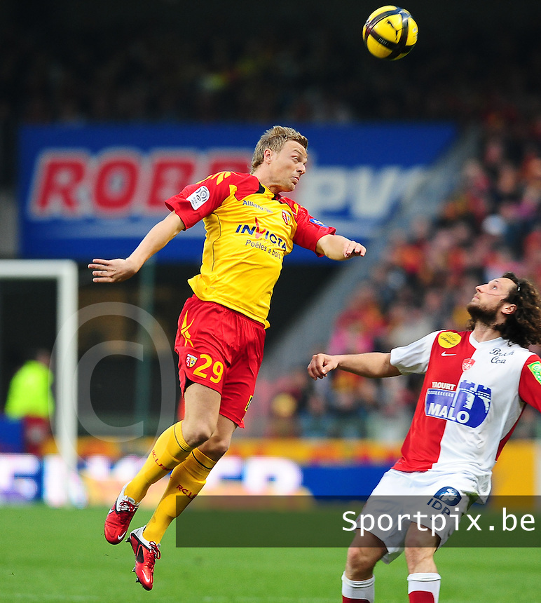 20110416 - LENS , FRANCE : RC Lens'  DAVID POLLET (left) pictured during the soccer match between Racing Club de LENS and BREST , on the thirty first  matchday in the French Ligue 1 at the Stade Bollaert Delelis stadium , Lens . Saturday 16 April 2011 . PHOTO DAVID CATRY