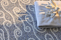 Eddies, a hand-chopped stone mosaic shown in Blue Bahia, Bardiglio, and Carrara, is part of the Silk Road collection by Sara Baldwin for New Ravenna.