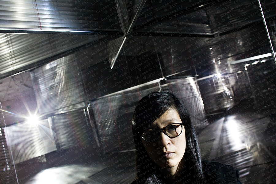 "Korean artist Haegue Yang poses for a portrait in her exhibition installation ""Arrivals"" at the Kunsthaus Bregenz."
