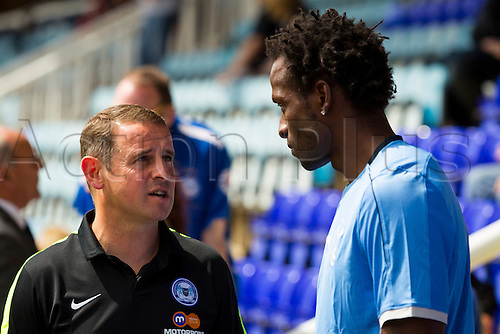 18.07.2015.  Peterborough, Engand. Pre Season Friendly Peterborough United versus Tottenham Hotspur. Peterborough United Manager Dave Robertson and Tottenham Hotspur Academy Coach Ugo Ehiogu