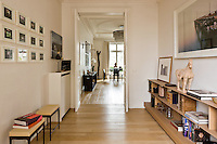The entrance hall works like a gallery with framed photographs by Irving Penn amongst others