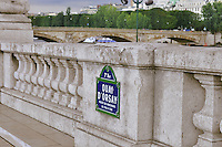 Quay d'Orsay, imbankment Orsay sign on the bridge