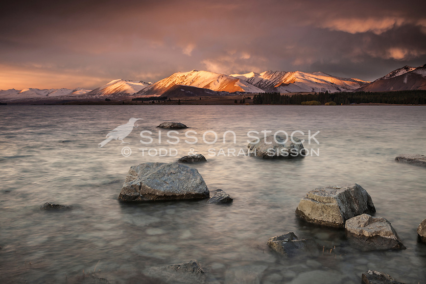 Spectacular sunset colours over Lake Tekapo and the Richmond Range.  South Canterbury New Zealand.