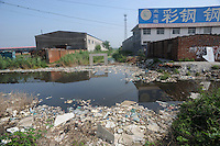 "The Tianyu Tong factory  at Xiditou is surrounded in a sea of chemical waste. Xiditou village is known as one of China's worse ""cancer villages"" where a reported ten percent have died from cancer."