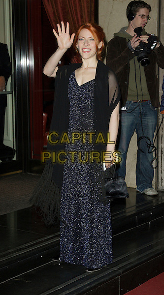 ELENA ROGER.Arrivals - Laurence Olivier Awards at the Grosvenor Hotel, Park Lane, London, England, February 18th 2007..full length blue sparkly dress hand waving.CAP/ROS.©Steve Ross/Capital Pictures.