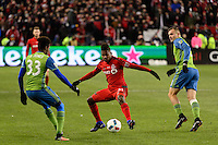Toronto, ON, Canada - Saturday Dec. 10, 2016: Joevin Jones, Armando Cooper, Jordan Morris during the MLS Cup finals at BMO Field. The Seattle Sounders FC defeated Toronto FC on penalty kicks after playing a scoreless game.