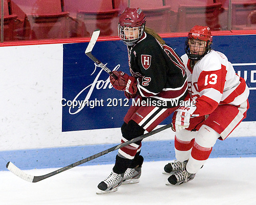 Samantha Reber (Harvard - 12), Kaleigh Fratkin (BU - 13) - The Boston University Terriers defeated the visiting Harvard University Crimson 2-1 on Sunday, November 18, 2012, at Walter Brown Arena in Boston, Massachusetts.