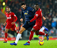 Manchester United's Marouane Fellaini battles with Liverpool's Naby Keita<br /> <br /> Photographer AlexDodd/CameraSport<br /> <br /> The Premier League - Liverpool v Manchester United - Sunday 16th December 2018 - Anfield - Liverpool<br /> <br /> World Copyright © 2018 CameraSport. All rights reserved. 43 Linden Ave. Countesthorpe. Leicester. England. LE8 5PG - Tel: +44 (0) 116 277 4147 - admin@camerasport.com - www.camerasport.com