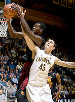 David Kravish of California fights for a loose ball during the game against USC at Haas Pavilion in Berkeley, California on February 17th, 2013.  California defeated USC, 76-68.