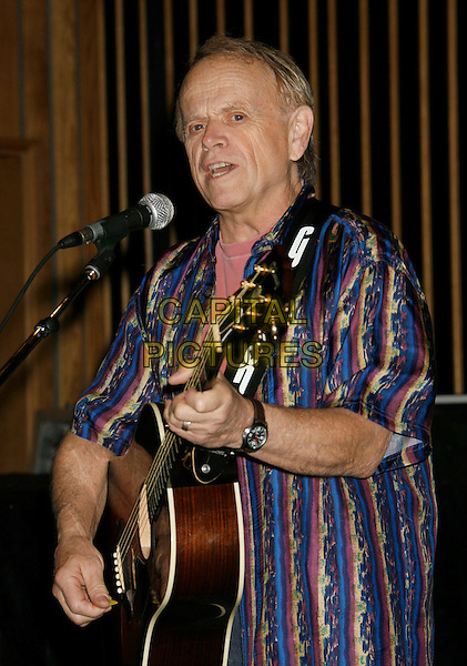 "AL JARDINE .Brian Wilson Performs Songs From ""Pet Sounds"" to Support ""Definitive 200"" Campaign held at Capitol Records Building,  Hollywood, California, USA..March 7th, 2007.half length blue striped stripes shirt microphone guitar stage live gig singing .CAP/ADM/RE.©Russ Elliot/AdMedia/Capital Pictures"