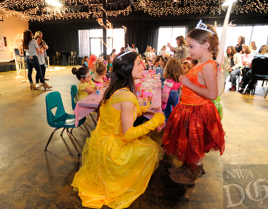 NWA Democrat-Gazette/ANDY SHUPE<br /> Zoe Hestekin (right), 6, of Fayetteville speaks Saturday, Feb. 20, 2016, with Addyson Hart, a junior at the University of Arkansas from Fort Smith who was dressed as Belle from Beauty and the Beast, during the third annual Princess for a Day event at Mermaids Restaurant in Fayetteville. The event offered an opportunity for children to interact with fairytale princesses, make crafts and have their nails and makeup done to raise money for Pagnozzi Charities. Visit nwadg.com/photos to see more photographs from the event.