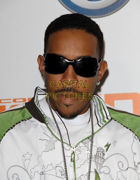 "CHRIS ""LUDACRIS"" BRIDGES.Attends Volkswagen US Premiere of Concept Tiguan held at Raleigh Studios in Los Angeles, California, USA,.November 28, 2006..portrait headshot sunglasses.CAP/DVS.©Debbie VanStory/Capital Pictures"