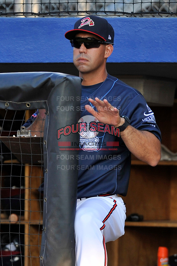 Pitching coach Gabe Luckert (27) of the Danville Braves watches the action from the dugout steps in a game against the Johnson City Cardinals on Friday, July 1, 2016, at Legion Field at Dan Daniel Memorial Park in Danville, Virginia. Johnson City won, 1-0. (Tom Priddy/Four Seam Images)