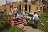 Trying to salvage what he can from his recently remodeled house Doug Houck,center, carts a rug out of whats left of his house with John Mizell, right, in the resdiential section of downtown Punta Gorda. The downtown section of Punta Gorda was devistated by Hurricane Charley blowing off roofs and completely demolishing businesses and homes. Erik Kellar/Naples Daily News