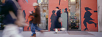 "Out takes from ""The Harvard Design School Guide to Shopping"" published by Tashen. Pedestrianswalk by a wall on West Broadway painted with a mural of silhoettes of pedestrians walking by. NYC 2000"