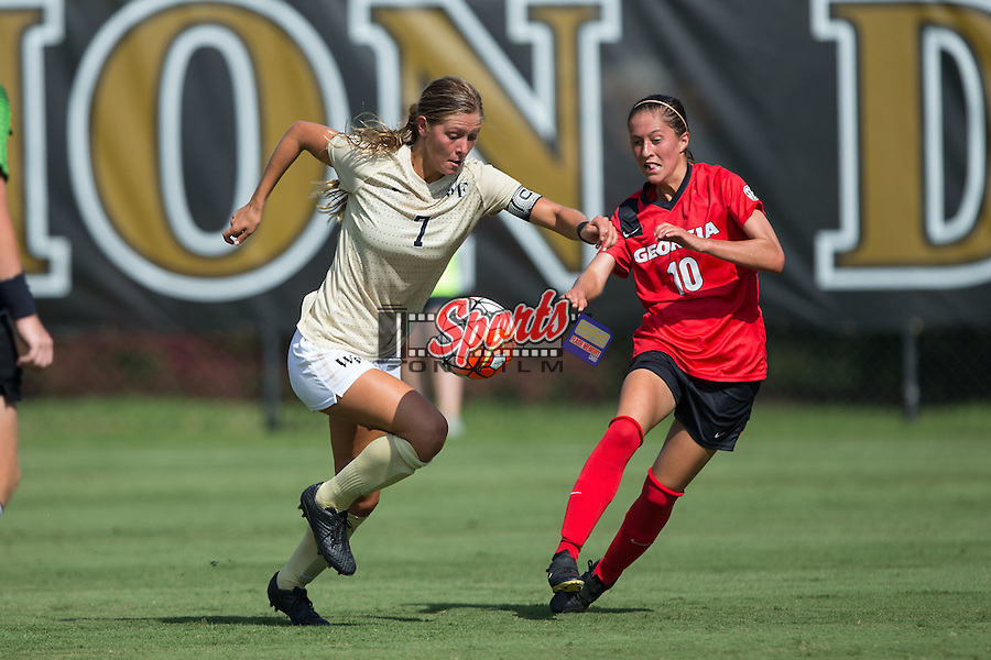 Sarah Teegarden (7) of the Wake Forest Demon Deacons keeps the ball away from Becca Rasmussen (10) of the Georgia Bulldogs during first half action at Spry Soccer Stadium on August 23, 2015 in Winston-Salem, North Carolina.  The Deacons defeated the Bulldogs 4-0.  (Brian Westerholt/Sports On Film)