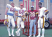 Washington Redskins players picked for the 1984 Pro Bowl, from left to right: tackle Joe Jacoby (66), guard Russ Grimm (68), cornerback Darrell Green (28), and wide receiver Art Monk (81) pose for a group photo at Old Redskins Park in Herndon, Virginia on December 13, 1984.<br /> Credit: Arnold Sachs / CNP
