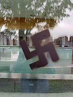 Pictured: A swastika graffiti in Newport, Wales, UK.<br /> Re: A man who set fire to two buildings and caused damage to several others in Newport, south Wales, with racist graffiti has been jailed for six years by Newport Crown Court.<br /> Austin Ross, 23, attended places such as The Riverfront Theatre and Newport Leisure Centre, sticking posters with racist propaganda to the buildings and spray painting swastikas. <br /> Ross also damaged schools and a church, as well as other buildings and landmarks, using racist posters and slogans.  <br /> The Masonic Lodge and Bassaleg Secondary School were not only damaged with graffiti but also set alight by Ross, causing tens of thousands of pounds worth of damage.