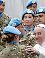 Papa Francesco saluta un gruppo di Caschi Blu dell'Onu al termine dell'udienza generale del mercoledi' in Piazza San Pietro, Citta' del Vaticano, 3 febbraio 2016.<br /> Pope Francis waves to a group of UN's Blue Berets peacekeeping soldiers at the end of his weekly general audience in St. Peter's Square at the Vatican, 3 February 2016.<br /> UPDATE IMAGES PRESS/Riccardo De Luca<br /> <br /> STRICTLY ONLY FOR EDITORIAL USE