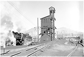 Steamy view of D&amp;RGW #495 on the Durango ash pit near the coaling tower.<br /> D&amp;RGW  Durango, CO  Taken by Richardson, Robert W.