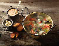 Classic French Bouabaise in a copper pan on a wood background
