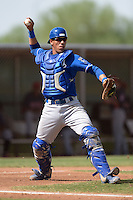 Kansas City Royals catcher Pedro Gonzalez (43) throws to first during an Instructional League game against the Cleveland Indians on October 9, 2013 at Surprise Stadium Training Complex in Surprise, Arizona.  (Mike Janes/Four Seam Images)