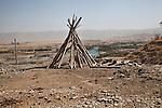 09/08/14. Goktapa, Iraq. The wood used to build the roofs of Goktapa's houses.
