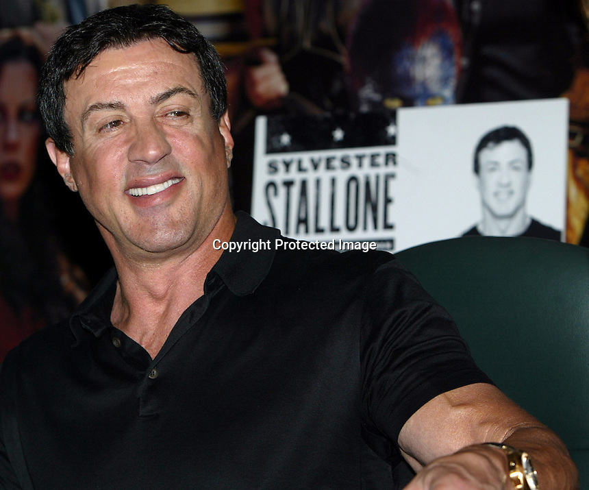 """5/24/05,Las Vegas,Nevada --- Actor Sylvester Stallone signs copies of his new book """"Sly Moves"""" at  Planet Hollywood.  --- Chris Farina"""