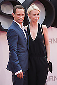 London, UK. 11 July 2016. German actor Vinzenz Kiefer with wife Masha Tokareva. Red carpet arrivals for the European Premiere of the Universal movie Jason Bourne (2016) in London's Leicester Square.