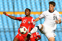 Conor Doyle (right) extens to kick the ball ahead of Panama player. USA Men's Under 20 defeated Panama 2-0 at Estadio Mateo Flores in Guatemala City, Guatemala on April 2nd, 2011.
