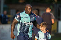Adebayo Akinfenwa of Wycombe Wanderers heads out with a young mascot during the Friendly match between Wycombe Wanderers and AFC Wimbledon at Adams Park, High Wycombe, England on 25 July 2017. Photo by Andy Rowland.
