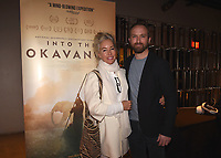 "HOLLYWOOD, CA - DECEMBER 4:  Sarah Argyropoulos and Director Neil Gelinas at National Geographic's ""Into the Okavango"" Premiere & Reception at at NeueHouse on December 4, 2018 in Hollywood, California. (Photo by Frank Micelotta/NatGeo/PictureGroup)"