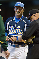 UCLA Bruins head coach John Savage #22 delivers the lineup card to home plate prior to taking on the Baylor Bears in the 2009 Houston College Classic at Minute Maid Park February 28, 2009 in Houston, TX.  The Bears defeated the Bruins 5-1. (Photo by Brian Westerholt / Four Seam Images)