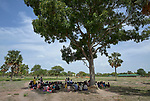 Villagers gather under a tree for a community meeting at the Loreto Primary School in Rumbek, South Sudan. While the school, run by the Institute for the Blessed Virgin Mary--the Loreto Sisters--of Ireland, focuses on educating girls from throughout the war-torn country, it also educates children from nearby communities, as well as operating a clinic and feeding program for local residents.