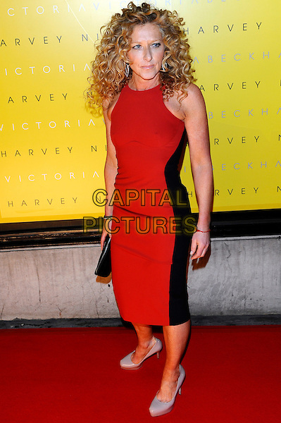Kelly Hoppen.attending the unveiling of 'Victoria by Victoria Beckham' Clothing Line during London Fashion Week, Harvey Nichols, Knightsbridge, London, England, UK, 17th February 2012..LFW full length red dress black side striped panel sleeveless  clutch bag .CAP/CJ.©Chris Joseph/Capital Pictures.