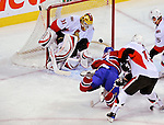 11 November 2008: Montreal Canadiens' left wing forward Christopher Higgins (21) takes a shot at goaltender Alex Auld of the Ottawa Senators in the first period at the Bell Centre, in Montreal, Quebec, Canada. The Canadiens shut out the Senators 4-0 as the Habs celebrate their 100th Season. ***Editorial Sales Only***..Mandatory Photo Credit: Ed Wolfstein Photo *** Editorial Sales through Icon Sports Media *** www.iconsportsmedia.com