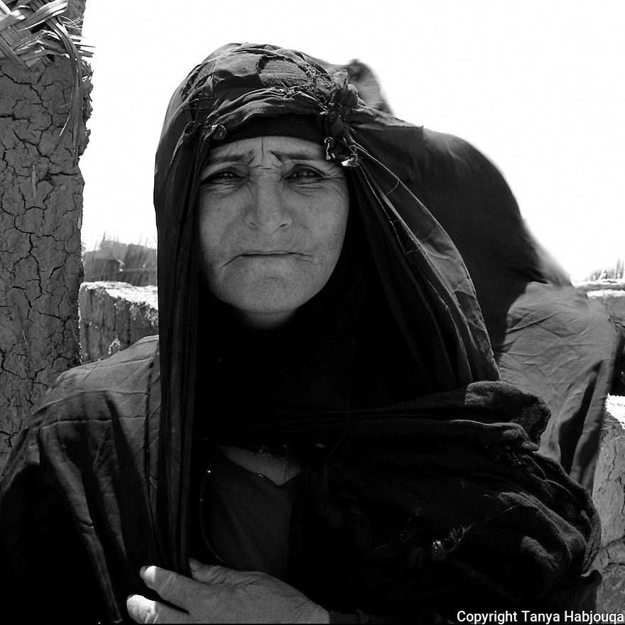 21st  July 2003.  Chibayish, Iraq... Medina, a mother of ten,  has returned to her marshland home after more than a decade, lured by the news that the marshes were miraculously coming back to life and that the land was no longer under Saddam's control. .. The displaced Marsh Arabs were forced off of their lands-- a connection that goes back centuries--when Saddam's regime drained the marshes, considered to be one of the greatest environmental crimes of the 21st century. <br /> <br /> The Marsh Arabs,  a proud people who once worked their ancestral lands with complete self-sufficiency were forced to flee, becoming migrant workers and cheap labourers across Iraq. Since the war's end, over 3,000 Marsh Arabs have returned home&Ntilde;and thousands more are expected. Yet these families who have been living in poverty for a decade are returning to little or no infrastructure of any kind, and scant opportunity for work. They have no access to potable water and the health clinics in the villages are already struggling to meet the high incidents of typhoid, dysentery, and skin lesions that are plaguing the local population.